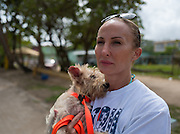 """Chrissy Beckles holds """"Scrappy,"""" a small dog just rescued from Guayanes Beach, Puerto Rico."""