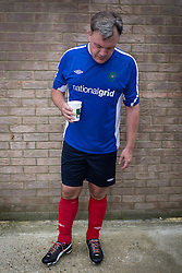 © Licensed to London News Pictures . 22/09/2013 . Lancing , UK . Shadow Chancellor Ed Balls ' looks at his rainbow laces worn in support of an anti homophobia in football campaign . Labour Party vs journalists football match . Day 1 of the Labour Party 's annual conference in Brighton . Photo credit : Joel Goodman/LNP