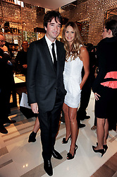 ELLE MACPHERSON and ANTOINE ARNAUD son of Bernard Arnaud at a party to celebrate the opening of the Louis Vuitton Bond Street Maison, New Bond Street, London on 25th May 2010.