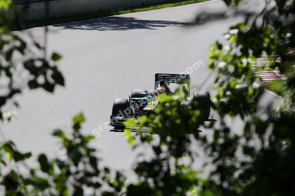 Heikki Kovalainen (Caterham-Renault) behind trees during practice for the 2012 Canadian Grand Prix in Montreal. Photo: Grand Prix Photo