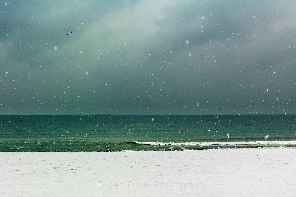 Snowing by the sea