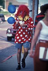 Man in colorful clown attire. Stock photo