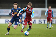 Mansfield Town George Maris (10) Scunthorpe United John McAtee (45) battles for possession during the EFL Sky Bet League 2 match between Scunthorpe United and Mansfield Town at the Sands Venue Stadium, Scunthorpe, England on 26 December 2020.