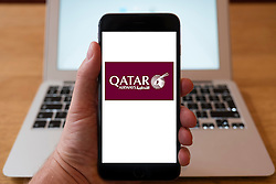 Using iPhone smartphone to display logo of Qatar Airlines,