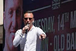 London, UK. 14 May, 2019. Danny Thomas, aka Danny Tommo, addresses supporters of former English Defence League leader Tommy Robinson before his appearance at the Old Bailey to face a hearing before two High Court judges for an allegation of contempt of court.