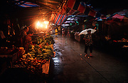 While still a Portuguese colony, 1990s monsoonal rain falls heavily in a Macau market of vegetable stalls, on 10th August 1994, in Macau, China. (Photo by Richard Baker / In Pictures via Getty Images)