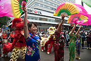 Chinese fan dance performers wearing traditional qipao dresses during the opening parade for the Birmingham Weekender Arts And Culture Festival on 23rd September 2017 in Birmingham, United Kingdom.