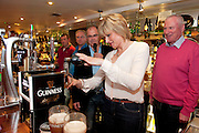 Pamela Moon , Kilrea N. Ireland, pulls a pint at the GUINNESS Mid-Strength Taste Test Tour. Guinness Master Brewer Fergal Murray and former Irish Rugby International Mick Galwey hosted the event, which featured a special Q&A on rugby and a Pour Your Pint Competition. .Full details are available on www.Facebook.com/Guinnessireland GUINNESS Mid-Strength has the unmistakable distinctive taste and is brewed in exactly the same way as GUINNESS, just with less alcohol at 2.8%...The GUINNESS word and associated logos are trademarks...Enjoy Guinness Sensibly...Visit www.drinkaware.ie..