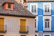 Traditional colourful architecture, terracotta roof tiles, ironwork balconies in Segovia, Spain
