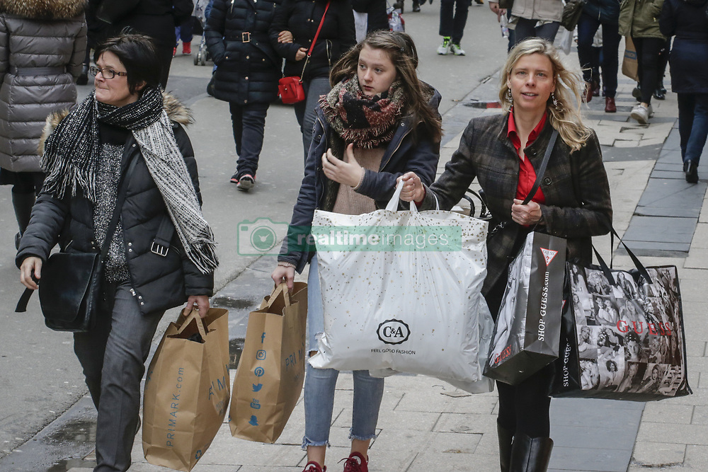 January 3, 2018 - Brussels, BELGIUM - Shoppers carry their bags as the official start of the winter sales begins in Brussels. Retail organizations expect the discounts to rise up to 50 percent and more at the start of the sales period.  (Credit Image: © Thierry Roge/Belga via ZUMA Press)