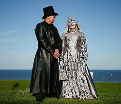© Licensed to London News Pictures. <br /> 01/11/2014. <br /> <br /> Whitby, Yorkshire, United Kingdom<br /> <br /> Ian and Isabella McDonald from Perth visit the Whitby Goth Weekend. <br /> <br /> The event this weekend brings together thousands of extravagantly dressed followers of Victoriana, Steampunk, Cybergoth and Romanticism who all visit the town to take part in celebrating Gothic culture. This weekend marks the 20th anniversary since the event was started by local woman Jo Hampshire.<br /> <br /> Photo credit : Ian Forsyth/LNP
