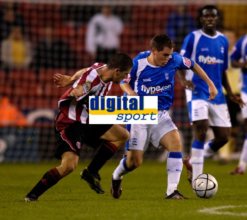 Photo: Jed Wee.<br /> Sheffield United v Birmingham City. Carling Cup. 24/10/2006.<br /> <br /> Birmingham's Neil Kilkenny (R) with Sheffield United's Nick Montgomery.