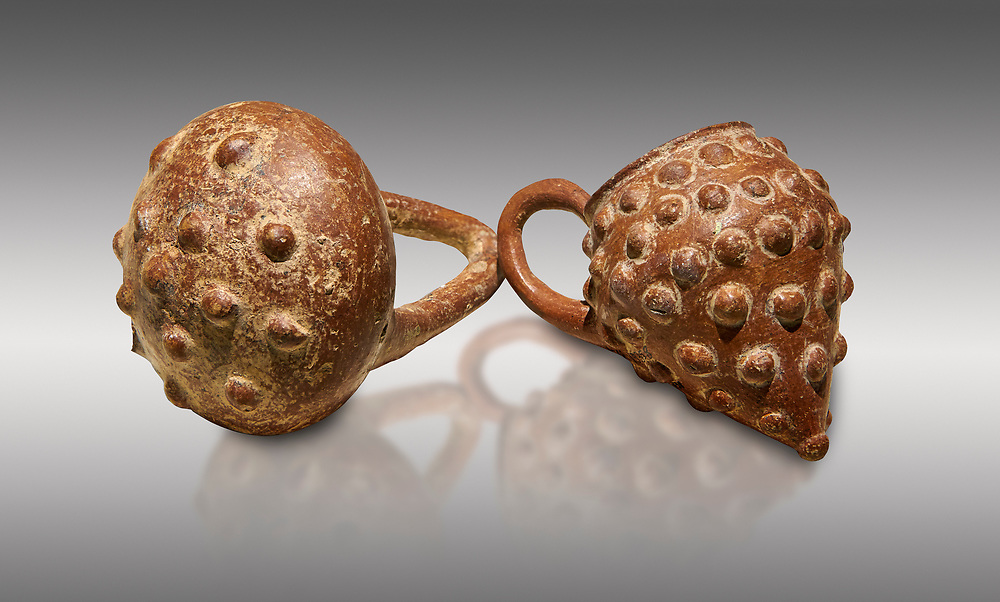 Bronze Age Anatolian terra cotta basket with handle & a beaker shaped as a bunch of grapes - 19th to 17th century BC - Kültepe Kanesh - Museum of Anatolian Civilisations, Ankara, Turkey. Against a grey background. .<br /> <br /> If you prefer to buy from our ALAMY PHOTO LIBRARY  Collection visit : https://www.alamy.com/portfolio/paul-williams-funkystock/kultepe-kanesh-pottery.html<br /> <br /> Visit our ANCIENT WORLD PHOTO COLLECTIONS for more photos to download or buy as wall art prints https://funkystock.photoshelter.com/gallery-collection/Ancient-World-Art-Antiquities-Historic-Sites-Pictures-Images-of/C00006u26yqSkDOM