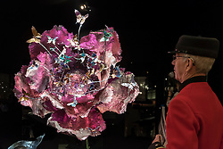 """© Licensed to London News Pictures. 29/06/2016. London, UK.  Chelsea Pensioner, David Jordan, looks at """"Rise of Heart"""", a titanium gemstone sculpture, by Wallace Chan, at the preview, in Chelsea, of Masterpiece London, the leading international fair for art and design from antiquity to the present day with works from 154 world-renowned exhibitors on sale.  The fair is open until 6 July.Photo credit : Stephen Chung/LNP"""