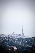 Snow on the Norman Foster designed Torre de Collserola at Tibidabo, and surrounding Parc Collserola, Barcelona
