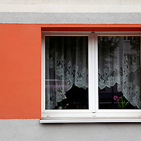Europe, Germany, Berlin. Window of housing in former East Berlin, painted with color with unification.