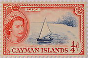 Cayman Island Stamp 1955 1/4d (one farthing) stamp illustrating the Catboat with Queen Elizabeth portrait. Published by the UK government for the Cayman Islands Post Office. The Cayman Islands is a self-governing British Overseas Territory in the western Caribbean Sea.
