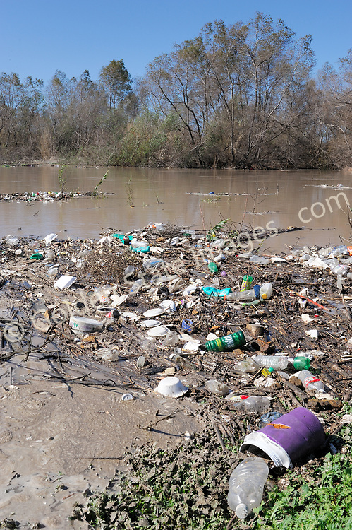 Winter storms flush huge quantities of raw sewage and floating trash from Tijuana Mexico down the Tijuana River to be deposited in the river estuary and ultimately in the ocean.
