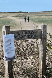 Covid 19 - Sign in a popular car park at a beauty spot in Dorset during lock down, UK March 2020