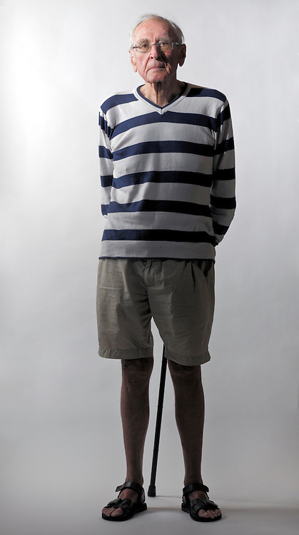 full length portrait of senior man with walking stick