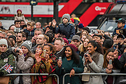 Crowds young and old watch from Piccadilly Circus - The New Years day parade passes through central London form Piccadilly to Whitehall. London 01 Jan 2017