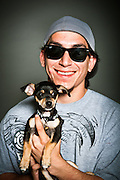 Rigo Valencia with his eight-week-old chihuahua puppy, Dollar.