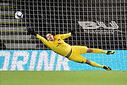 Asmir Begovic (1) of AFC Bournemouth at full stretch but can't get a hand to the shot from Michy Batshuayi (23) of Crystal Palace in the penalty shootout during the EFL Cup match between Bournemouth and Crystal Palace at the Vitality Stadium, Bournemouth, England on 15 September 2020.