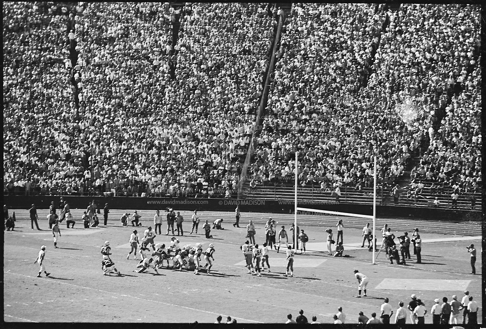 COLLEGE FOOTBALL:  Stanford vs USC (#4 ranking) on October 10, 1970 at Stanford Stadium in Palo Alto, California.  Stanford won by a final score of 24-14.  Visible players include kicker Steve Horowitz #56, holder Steve Murray #25.  Photograph by David Madison / www.davidmadison.com.  R0067