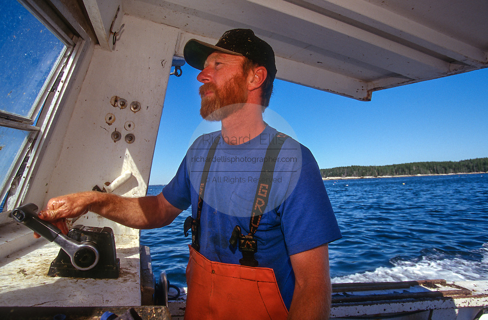 Lobster fisherman in his boat along the mid-coast of Maine.