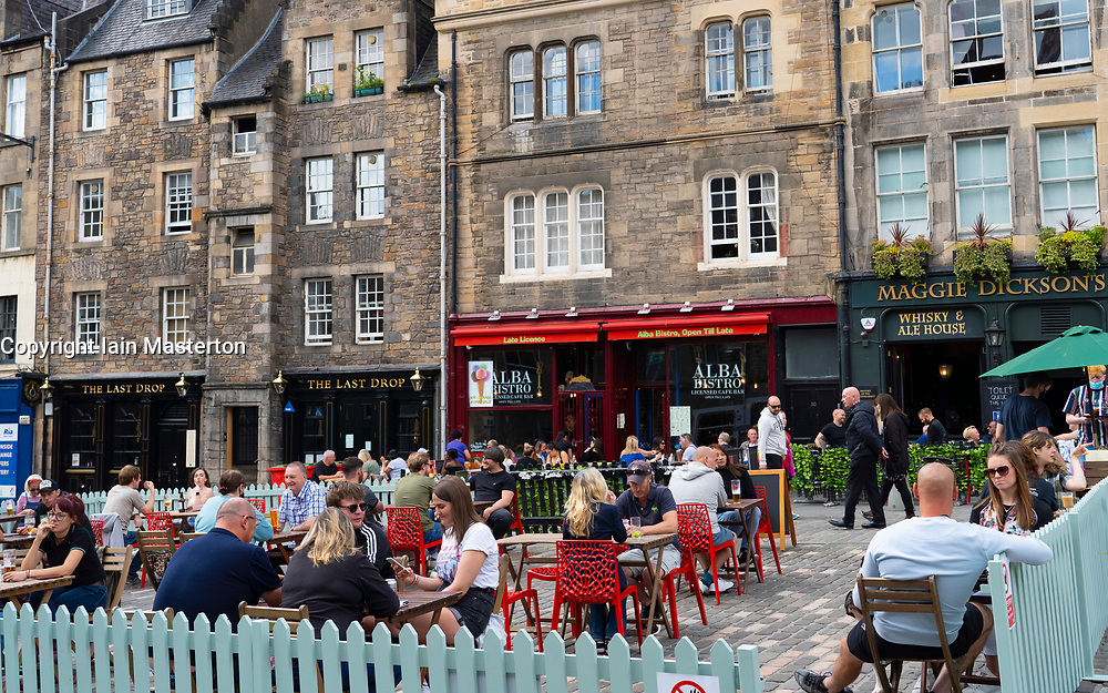 Edinburgh, Scotland, UK. 12 July, 2020, Business slowly returning to normal in Edinburgh city centre. Tourists still almost non existent and streets remain very quiet in the Old Town. Outdoor seating in beer gardens in the The Grassmarket are popular. Iain Masterton/Alamy Live News