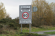 'Welcome to Northern Ireland', the word northern painted over. At the border of Ireland with Northern Ireland south of Newry, north of County Louth. Its the A1 Road in the north and N1 (National Primary Road) in the south. Easy to change your Euros for pounds, buy cheap petrol one side of the border, cheap drink the other. Many business exist because of the open borders. A hard border would gravely affect the economy of the border counties, and Ireland as a whole