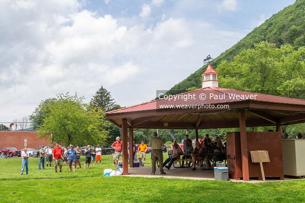 People gathered in 16th Street Park during a rally against a proposed natural gas power plant in Renovo, Pennsylvania on July 17, 2021. The Pennsylvania Department of Environmental Protection granted a permit in April 2021 for Renovo Energy Center LLC to construct and operate a gas-fired power plant in Renovo Borough. (Photo by Paul Weaver)