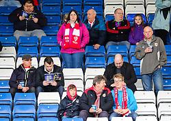 Bristol City fans check their programmes ahead of kick off  - Photo mandatory by-line: Matt McNulty/JMP - Mobile: 07966 386802 - 03/04/2015 - SPORT - Football - Oldham - Boundary Park - Oldham Athletic v Bristol City - Sky Bet League One