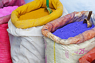 Moroccan dye in plastic bag in the medina of Chefchaouen, Morocco.
