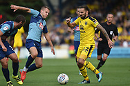 Oxford United midfielder (on loan from Sheffield United) Ricky Holmes) (12) battles for possession during the EFL Sky Bet League 1 match between Wycombe Wanderers and Oxford United at Adams Park, High Wycombe, England on 15 September 2018.