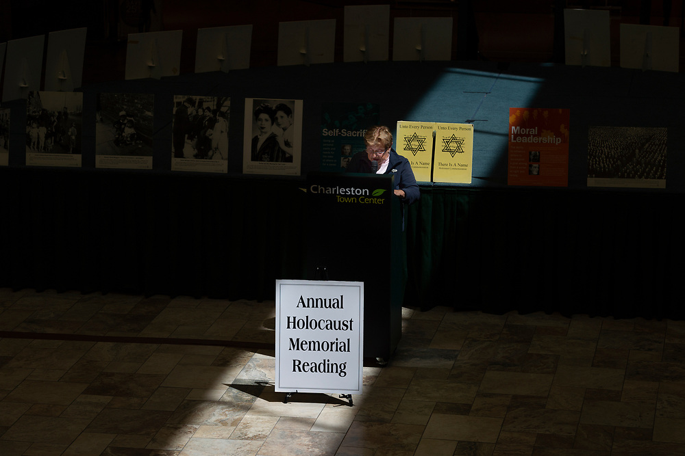 """Margot Jogwick announces the names of those who were murdered in the Holocaust during the 24th Annual """"Unto Every Person There Is a Name"""" Holocaust Memorial Program at the Charleston Town Center Mall. in Charleston, W.V., on Thursday, April 12, 2018. Jogwick was born in 1934, and lived in the Jewish Quarter of Berlin despite not being jewish herself. She was a witness to kristallnacht and lived in Berlin for the entire duration of the war; seeking shelter in bunkers with her family during the Battle of Berlin in April 1945, which ended with Hitler's suicide and the surrender of Nazi Germany. """"It looked like Syria. Everything was rubble"""" she said. She lived in the Soviet sector of Berlin until 1958 when she emigrated to the United States."""