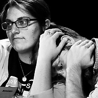 Kristen Durnace holds the head of Nate Beach after unfavorable poll numbers are posted for Hillary Clinton at Summit Saloon on Tuesday, Nov 8, 2016.