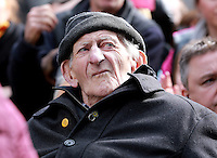 Eighty seven year old Michael Conneely from Galway looks over towards the noisy protesters before the  Wreath laying ceremony on Dublin's  Moore Street. Picture Credit:Frank Mc Grath<br /> 28/3/16