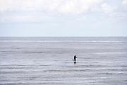 Nederland, the Netherlands, Egmond aan zee, 31-8-2018Een man peddelt op een surfplank in zee.Foto: Flip Franssen