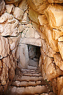 Entrance to Mycenae water cisterns for underground water storage. Excavated by the archaeologist Heinrich Schliemann in 1876.  Mycenae UNESCO World Heritage  Archaeological Site, Peloponnese, Greece . <br /> <br /> Visit our MYCENAEN ART PHOTO COLLECTIONS for more photos to download  as wall art prints https://funkystock.photoshelter.com/gallery-collection/Pictures-Images-of-Ancient-Mycenaean-Art-Artefacts-Archaeology-Sites/C0000xRC5WLQcbhQ<br /> .<br /> <br /> Visit our GREEK HISTORIC PLACES PHOTO COLLECTIONS for more photos to download or buy as wall art prints https://funkystock.photoshelter.com/gallery-collection/Pictures-Images-of-Greece-Photos-of-Greek-Historic-Landmark-Sites/C0000w6e8OkknEb8