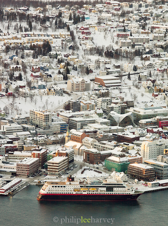A city view including a large passenger ferry at Tromso, Norway, seen from Mount Storsteinen