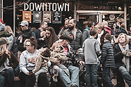 People wait alongside Main Street for the annual Christmas Parade to begin in Johnson City, Tennessee. (December 7, 2019)