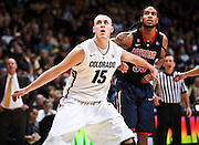 SHOT 1/21/12 5:57:50 PM - Colorado's Shane Harris-Tunks #15 tries to box out Arizona's Jesse Perry #33 during their PAC 12 regular season men's basketball game at the Coors Events Center in Boulder, Co. Colorado won the game 64-63..(Photo by Marc Piscotty / © 2012)