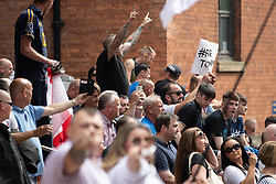 © Licensed to London News Pictures. 01/06/2018. Leeds, UK. Supporters of EDL founder Tommy Robinson ( real name Stephen Yaxley-Lennon ) demonstrate outside Leeds Crown Court after Robinson was convicted of Contempt of Court . Robinson was already serving a suspended sentence for Contempt of Court over a similar incident , when he was convicted on Friday 25th May 2018 . Reporting restrictions , since lifted , initially prevented coverage of Robinson's arrest and incarceration . Photo credit: Joel Goodman/LNP