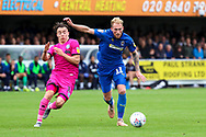 AFC Wimbledon midfielder Mitchell (Mitch) Pinnock (11) shaping up to shoot during the EFL Sky Bet League 1 match between AFC Wimbledon and Rochdale at the Cherry Red Records Stadium, Kingston, England on 5 October 2019.