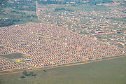 Aerial view of a human settlement in the Brazilian rainforest showing signs of deforestation