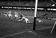 19/08/1962<br /> 08/19/1962<br /> 19 August 1962<br /> All Ireland Football Semi Final: Cavan v Roscommon at Croke Park, Dublin. Roscommon goalie A. Brady stops a daring attempt on goal by a lone Cavan man.