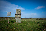 Maen Hir Tregwehelydd Standing Stone surrounded by farmland on 16th February 2020 in Anglesey, North Wales. A restored and re-erected monolith that stands on a low rise close to the river Alaw. The stone, which had shattered into three fragments, is 2.6m high by 0.9m wide by 0.76m thick. In 1969 it was bound by iron hoops and was set in concrete.Standing stones are a common site across North Wales.