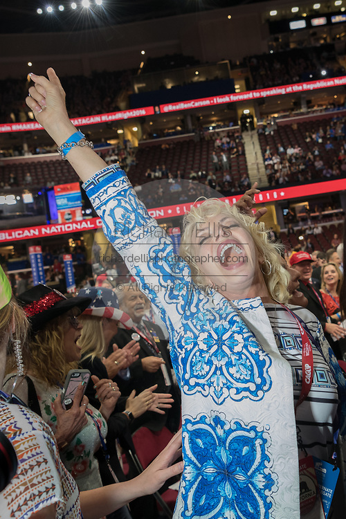 GOP California delegates dance in the aisles during the Republican National Convention July 20, 2016 in Cleveland, Ohio.