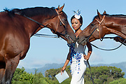 Bonang Matheba with  Futura (left) and Legislate (right). Photographed at Snaith Racing, Cape Town for the L'Ormarins Queens Plate. Image by Greg Beadle Commercial photography commissioned to Beadle Photo by international brands